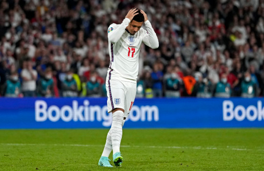 England's Jadon Sancho reacts after he missed to score during the penalty shootout of the Euro 2020 soccer championship final between England and Italy at Wembley stadium in London, Sunday, July 11, 2021. (AP Photo/Frank Augstein, Pool)